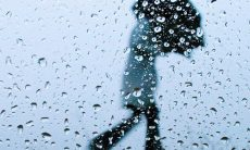 Rainfall with person holding umbrella