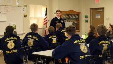 Logan Korff talks to students at Litton Agriculture Center