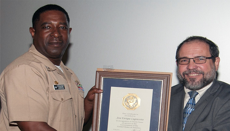 DAHLGREN, Va. (Sept. 28, 2017) - Naval Surface Warfare Center Dahlgren Division (NSWCDD) Commanding Officer Capt. Godfrey 'Gus' Weekes presents NSWCDD senior engineer Jose Lugo with a certificate recognizing Lugo's 30 years of government service. (U.S. Navy photo by Dan Eberly)