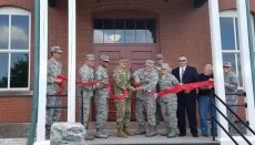 Missouri National Guard's adjutant general, U.S. Army Maj. Gen. Steve Danner (center left) and Missouri Air National Guard 131st Bomb Wing commander, Col Ken Eaves, cut the ribbon that officially opens historic building 29 at Jefferson Barracks Air National Guard Base.