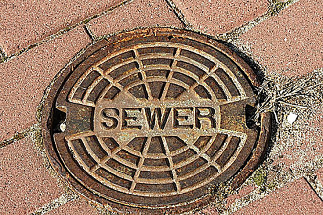 Sewer manole cover