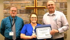 Emily Jones(middle) receives the Wright Memorial Hospital Employee of the Quarter Award for fourth quarter 2017 from Gary Jordan, CEO (right), and Bob Moore, manager, Radiology (left).