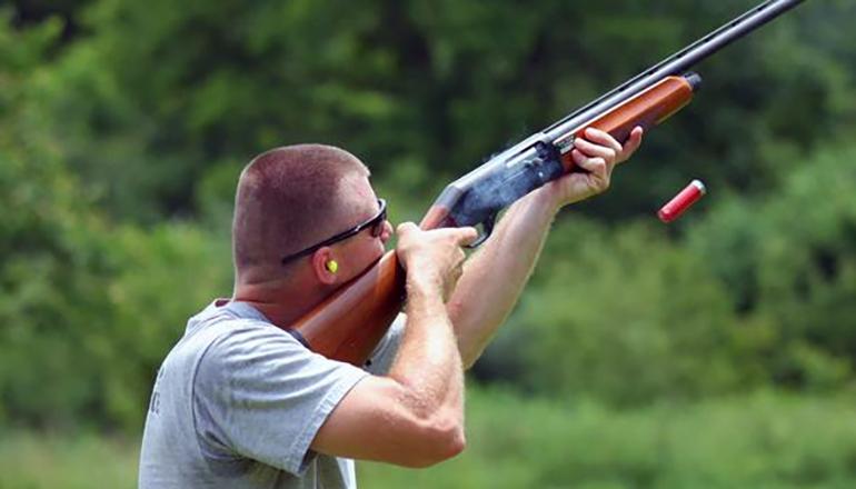Man Firing Shotgun