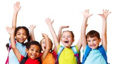 Children with hands raised