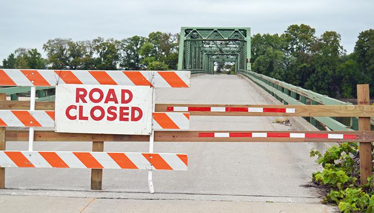 Road Closed leading to bridge