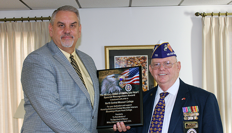 Pictured is President, Dr. Lenny Klaver receiving the designation from Senior Vice Commander, Walter Schley.