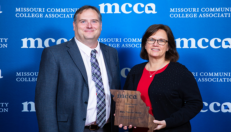Pictured is Cecilia with Dr. Tristan Londre, NCMC Vice President, receiving her award at the annual MCCA convention held in Branson, Missouri
