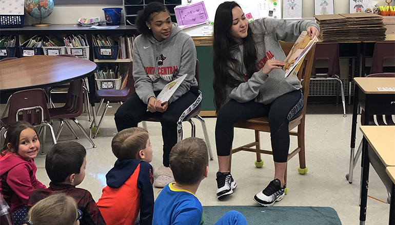 NCMC Students read to Rissler Classroom