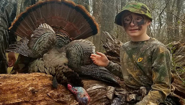 Young Turkey Hunter with Turkey