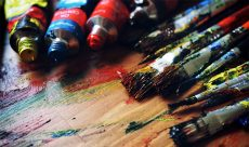 Arts or paintbrushes with paint for artists