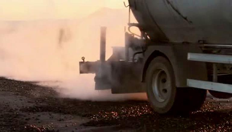 Applying Oil on Road