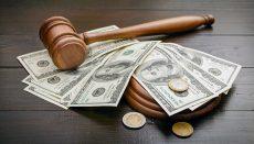 Bail Bond or Gavel on desk with cash