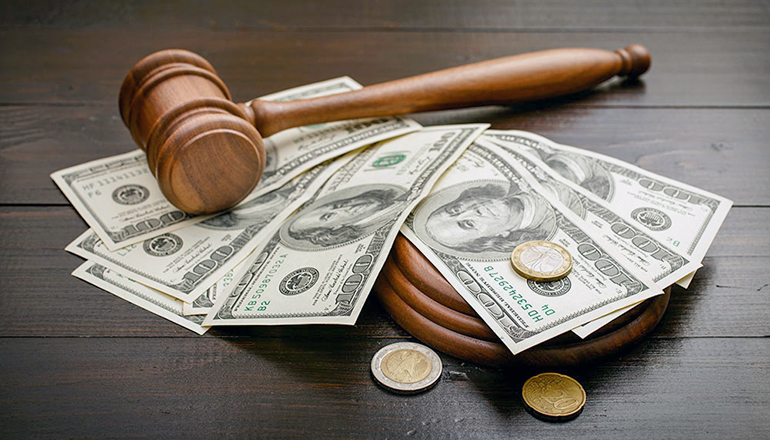 Bail Bond or Gavel on desk with cash