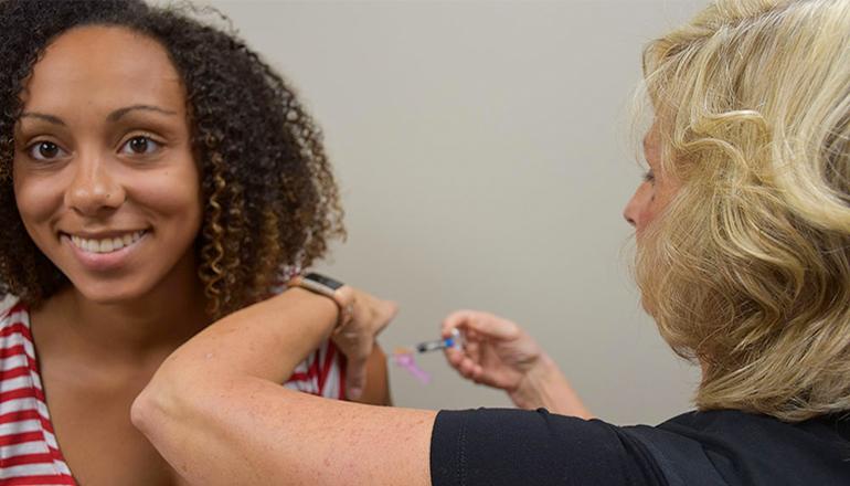 Woman getting flu shot