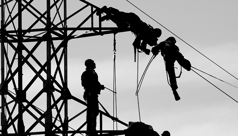 Linemen on electric tower