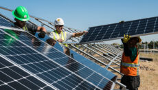 Construction workers installing solar panels
