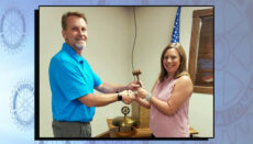 The passing of the gave between Past President Kim Washburn and new Rotary President Brian Upton