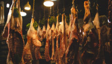 Meat hanging in a freezer