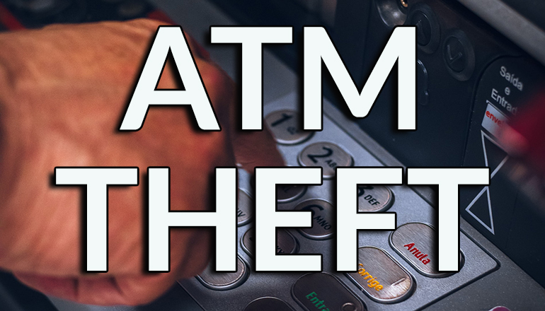 Person using ATM (Photo courtesy Eduardo Soares on Unsplash)