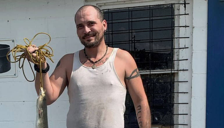 Carlin Allison of Doniphan nabs state record for American eel (Main Story Photo by Mo Dept of Conservation)