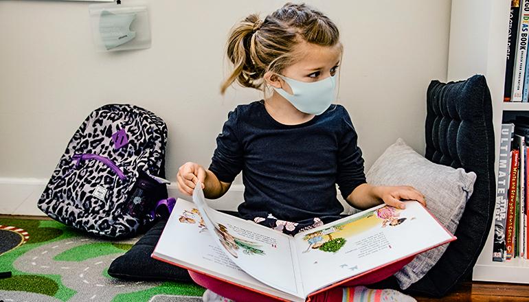 Little Girl in Class at School Wearing Mask