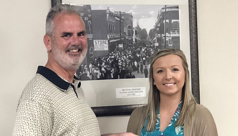 Megan Derry receiving the Paul Harris award from her uncle, Don Purkapile