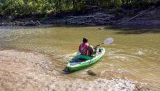 Person in Kayak on River enjoying float trip