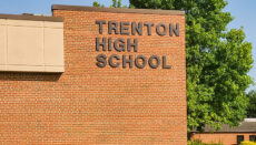 """Photo of Trenton High School building with the sign """"Trenton High School"""" or THS"""