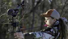 Girl holding bow and arrow