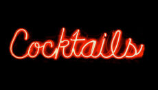 Neon red sign that says cocktails (liquor)