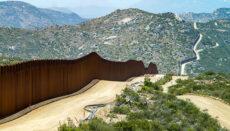 Photo of border wall (Photo via Greg Bulla on Unsplash)